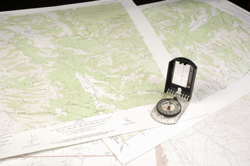several topo Maps and compass