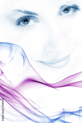 Beutiful girl's face toned in blue with abstract colorful smoke