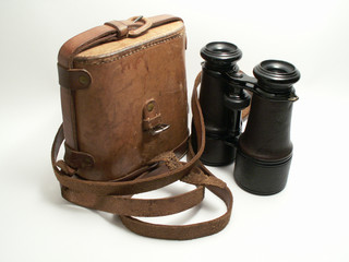 Old military binoculars with leather case