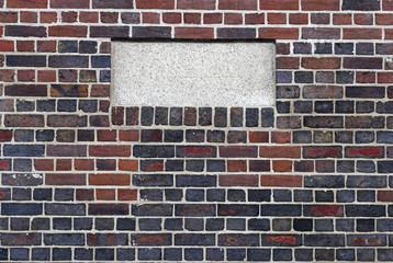 Blank frame on brick wall