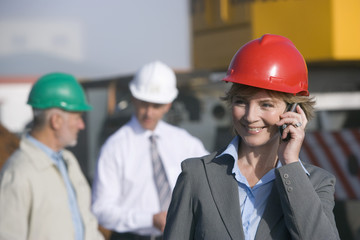 Engineer talking on cellphone on location