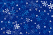 Various forms and sizes snowflakes background