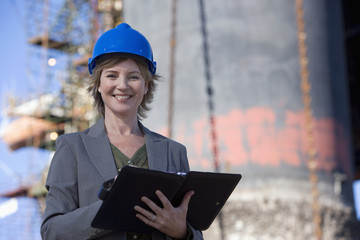 Woman oil platform engineer on the phone