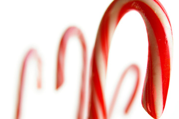Closeup of Christmas candy canes on white background