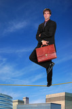 Businessman Standing on Tightrope