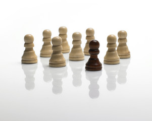 chess pawns / standing out of the crowd