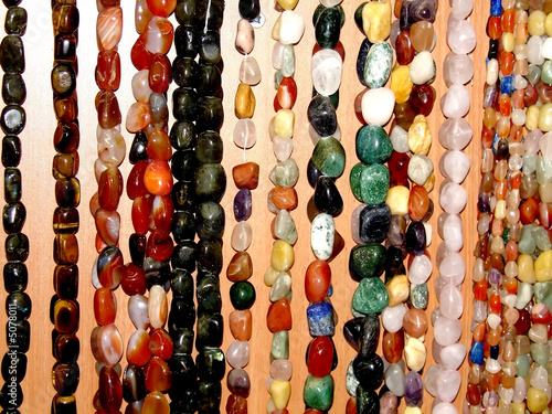 Assorted strings of gem stones beds