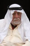 old arabian man listening poster