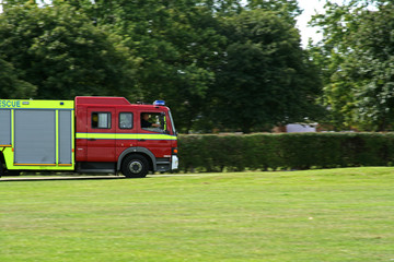 english fire engine attending an emergency call at speed