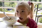 Little girl has a breakfast in open air 2   poster