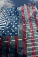 us stars and stripes projected onto corporate building