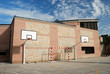 An open basket ball court in a school