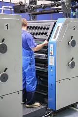 print equipment and worker
