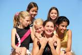 Fototapety Woman and five girls