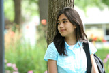 Young Teen girl ready for High School , quietly waiting  poster
