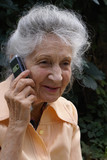 Smiling senior woman with sell phone