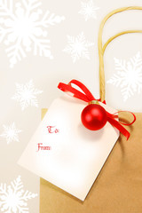 Holiday gift card with red ribbon