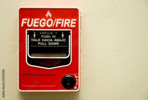 a red fire alarm mounted on a wall