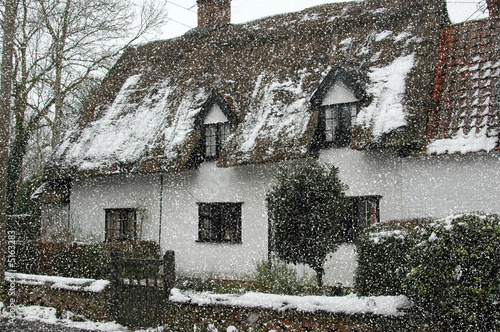 traditional english cottage in the snow