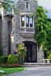 elegant stone fronted home entrance with bay window