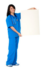 female nurse holding a white card
