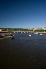 Prague river Vltava, bridge and ships view from Charles