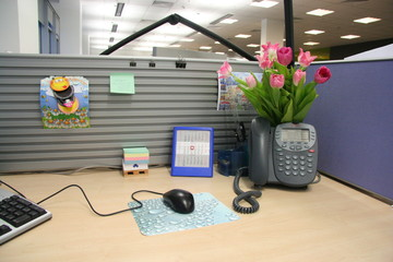 Office desk with phone and flowers