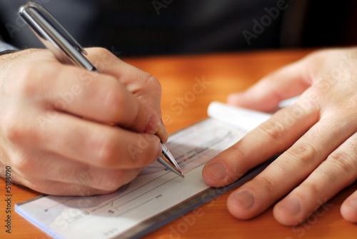 Man writing a check - 5184090