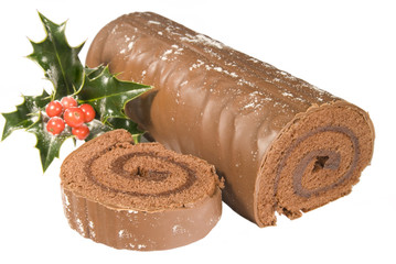 Sliced Christmas yule log with decoration on white background