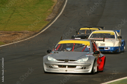 Foto op Canvas Snelle auto s race cars on track