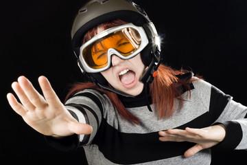 Girl wearing a ski helmet and googles