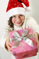 Young Santa Claus with gift