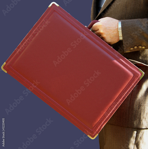 Businessman carrying a modern leather briefcase