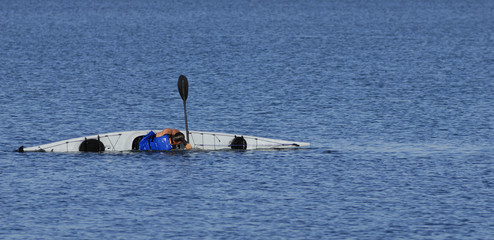 Kayaker performs a float-assisted roll