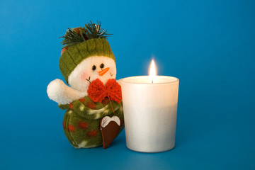 Snowman and candle