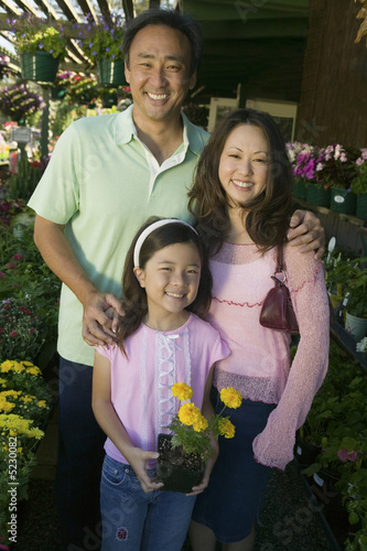 Family Shopping for Plants in nursery, portrait, front view