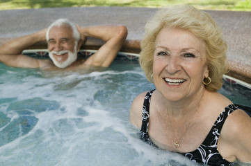 Senior Couple in Hot Tub, portrait.