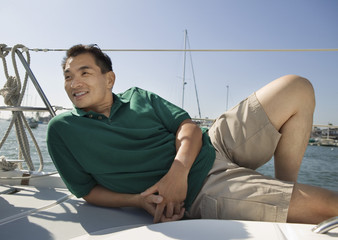 Man relaxing on sailboat