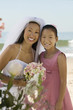 Bride and sister on beach, portrait