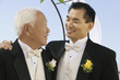 Groom with father, outdoors, close-up