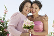 Mother and Bride with bouquet, outdoors, portrait