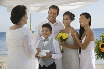 Bride and Groom with family at beach wedding