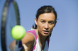 Female Tennis Player Hitting Ball, close up of racket, focus on player