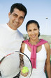 Mixed doubles Tennis Players standing on tennis court, portrait