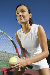 Female Tennis Player Preparing to Serve, close up