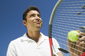 Male Tennis Player Preparing to Serve, close up, low angle view