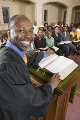 Preacher at altar with Bible preaching to Congregation, portrait