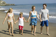 Family Holding Hands on Beach