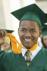 Graduate Holding Medal outside