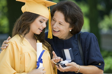 Graduate Receiving bracelet from Grandmother outside